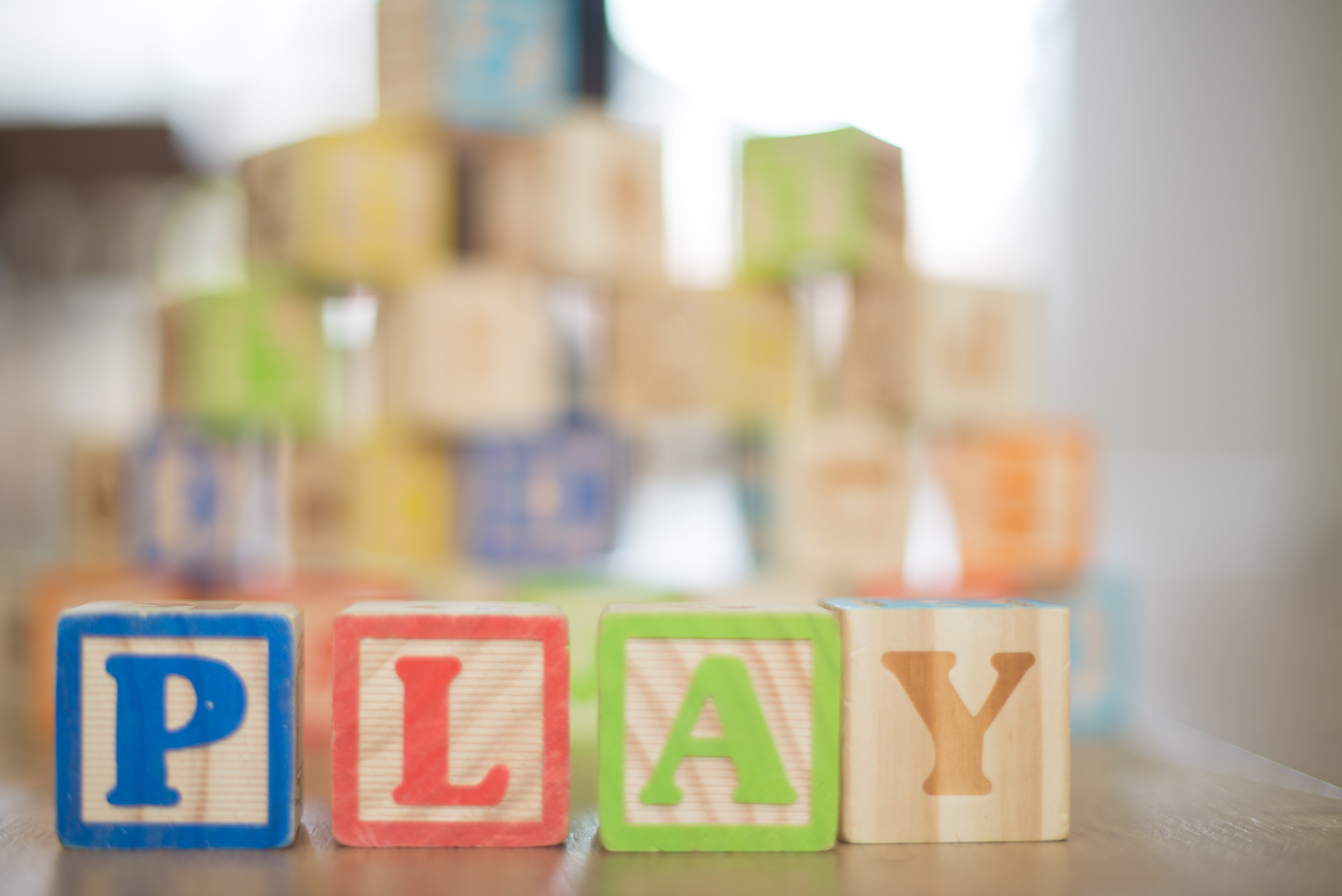 Image of wooden blocks spelling out PLAY.