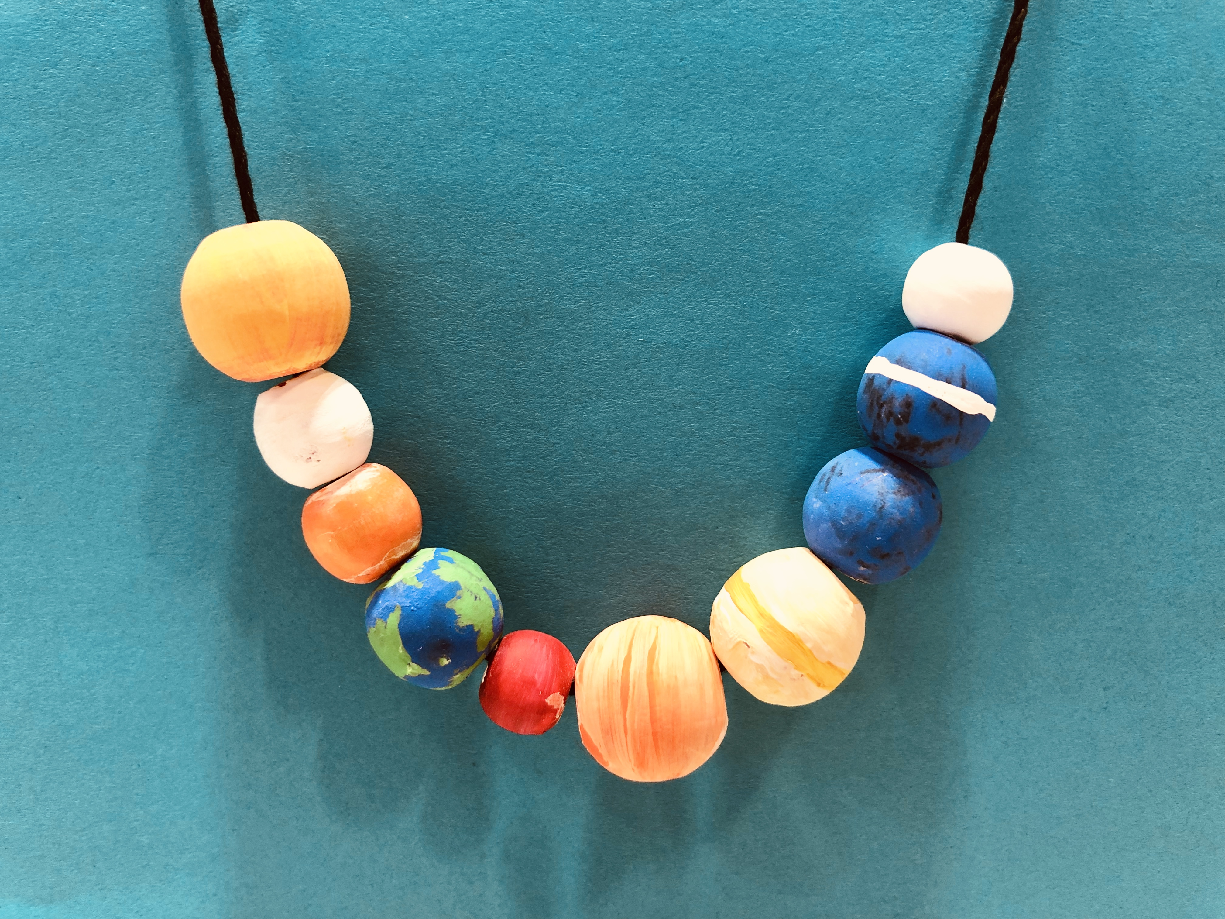 Image of the solar system necklace.