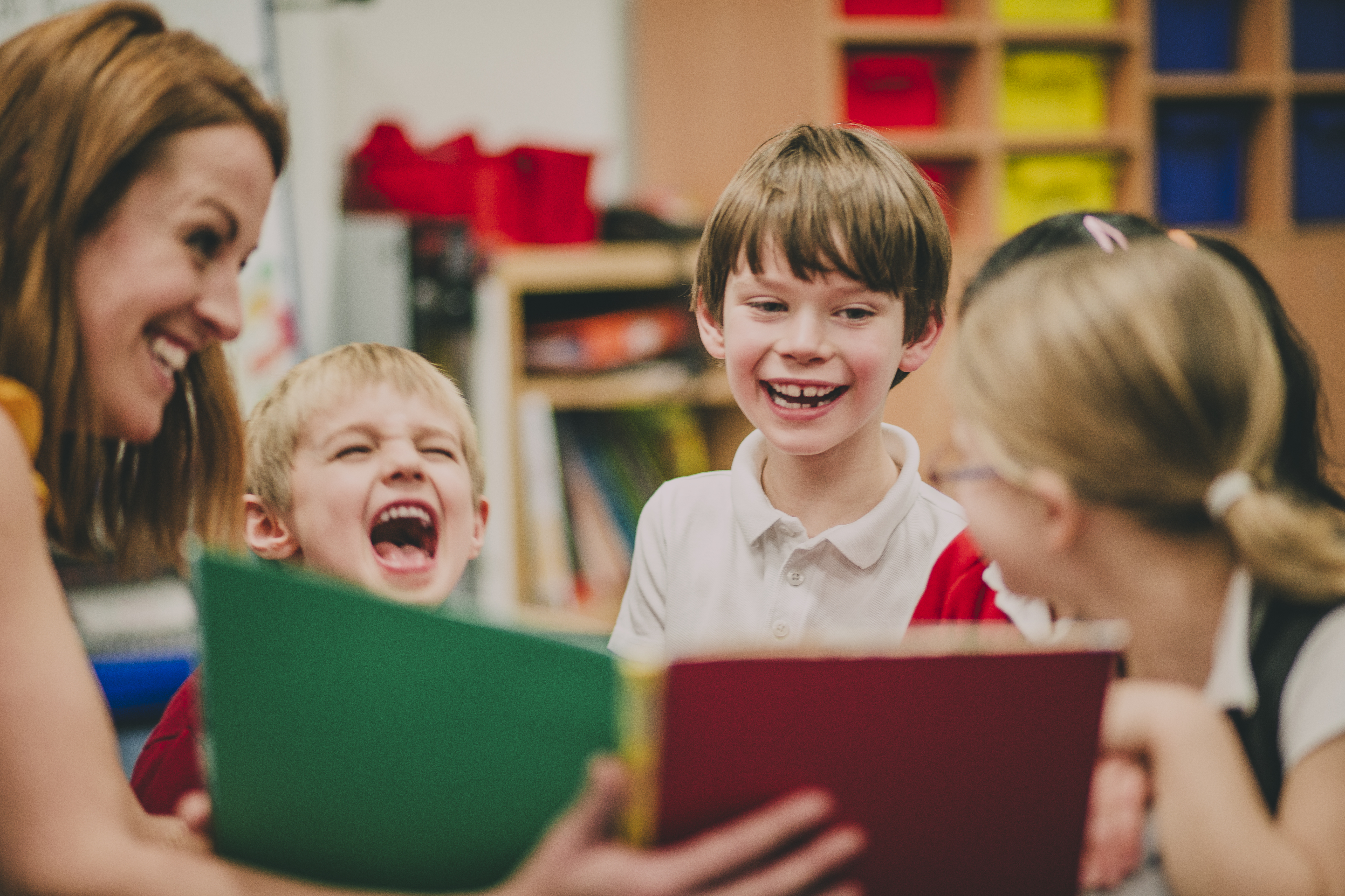 An image of preschoolers laughing.