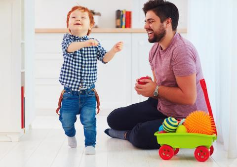 Laughing child with father